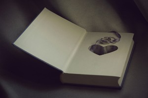 heart and rings inside book